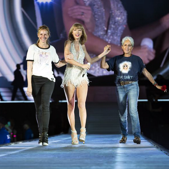 Joan Baez appears onstage with Taylor Swift